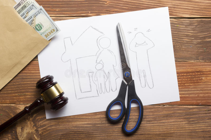 Family law concept. Divorce section of the property by legal means. Scissors cutting paper stock photography