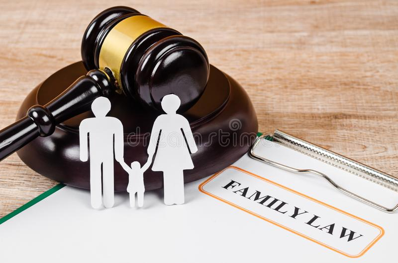 Family law concept. Family figure and gavel on table. Family law concept stock photo