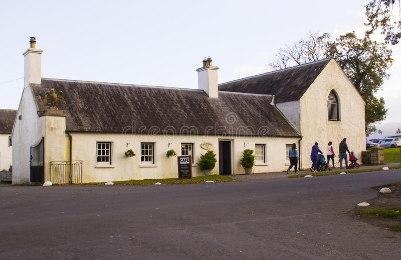 A family leaving the small tea shop in Castlewellan Country Park during a mid term school break. stock image
