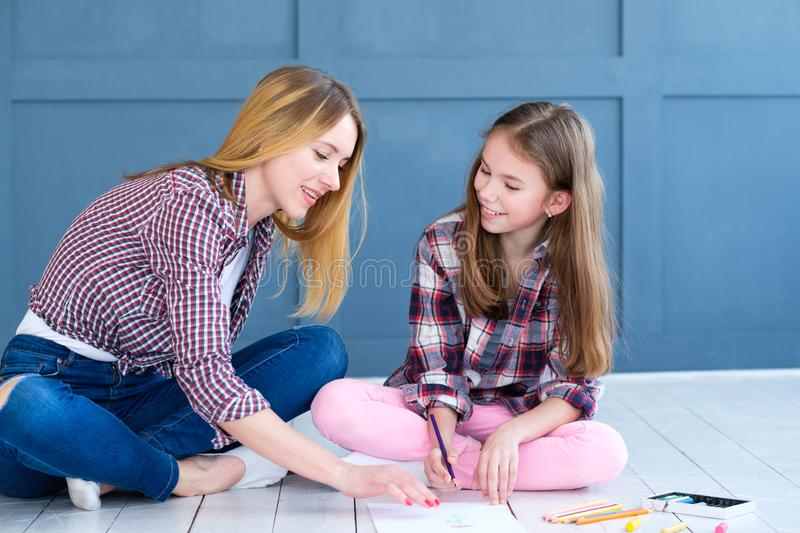 Family leisure mom daughter drawing together home. Family leisure. mom and daughter drawing together at home. parenting moments stock photography