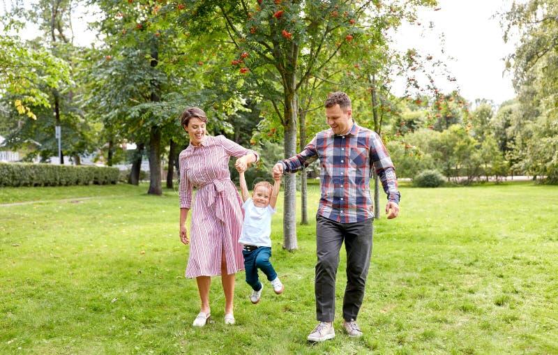 Happy family having fun at summer park royalty free stock photo