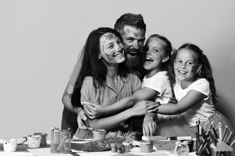Family leisure time and art concept. Artists family hugs and smiles. Girls, man and woman stock image