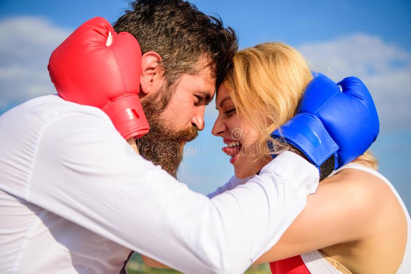 Family life happiness. Reconciliation and compromise. Fight for your happiness. Man and girl cuddle happy after fight. Couple in love boxing gloves hug sky stock photo