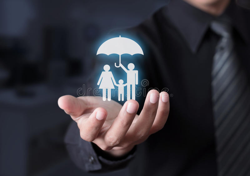 Family life insurance. Concept on business man hand stock photography