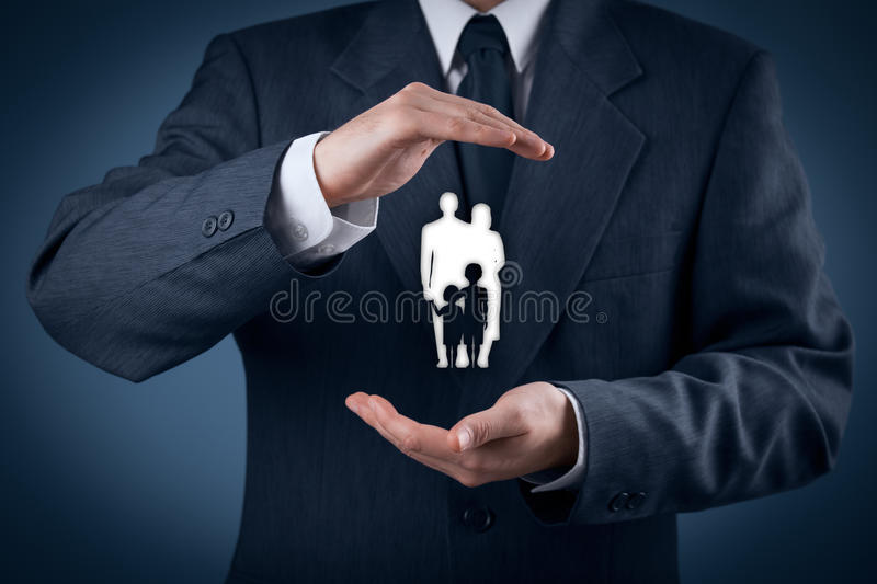 Family life insurance and policy. Family life insurance, family services, family policy and supporting families concepts. Businessman with protective gesture and stock photos