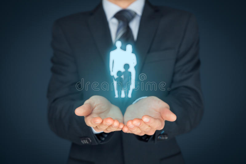 Family life insurance and policy. Family life insurance, family services and supporting families concepts. Businessman with protective gesture and silhouette royalty free stock photography