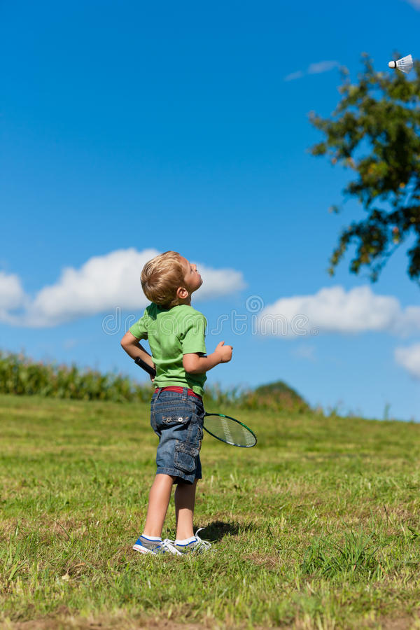 Download Family - Little Boy Playing Badminton Outdoors Stock Photography - Image: 23688092