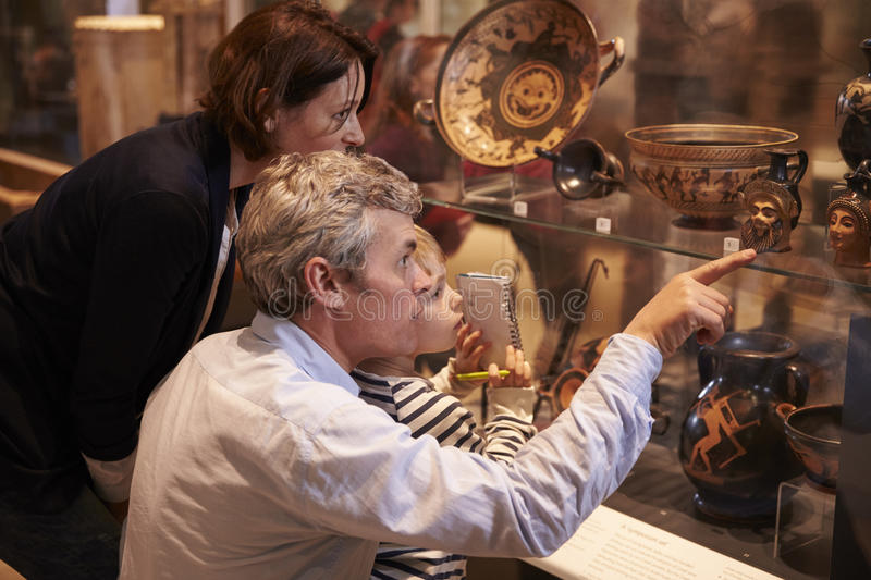 Download Family Looking At Artifacts In Glass Case On Trip To Museum Editorial Image - Image: 76294260