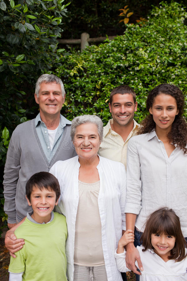Download Family Looking At The Camera In The Garden Stock Image - Image: 18101185