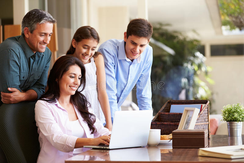 Family Looking At Laptop Together. At Home Browsing The Net royalty free stock image