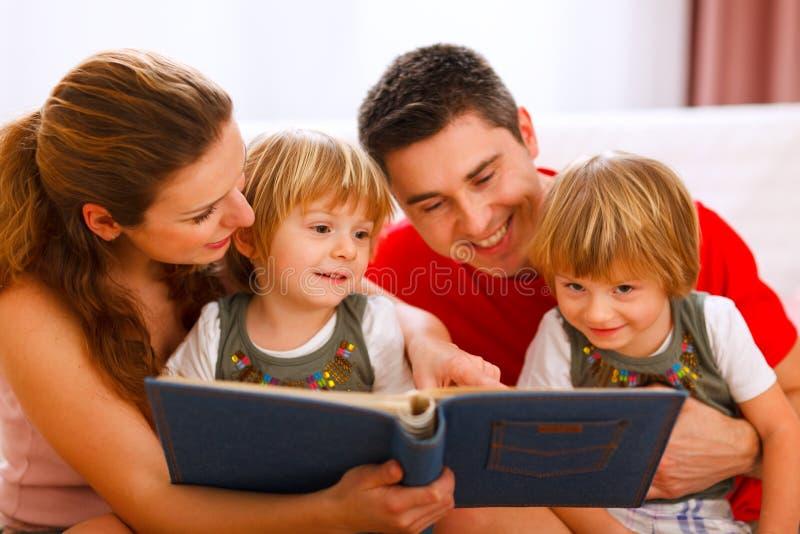 Family looking photo album royalty free stock image