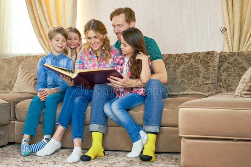 Family looking at photo album. royalty free stock photo