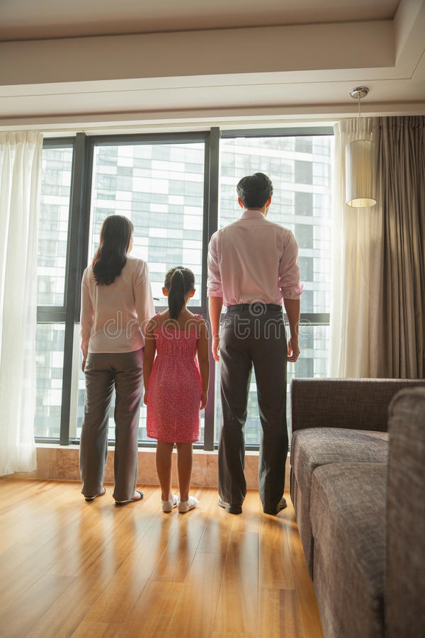 family looking through the window stock image