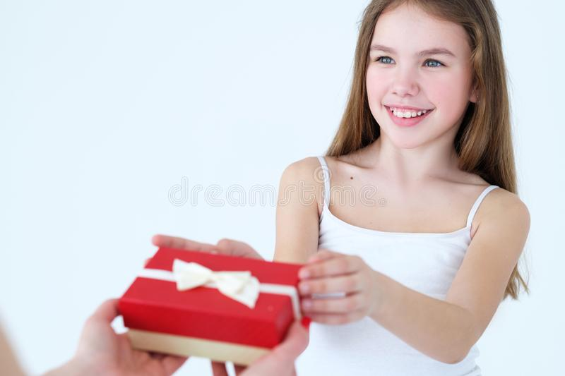 Family love care mother present gift box child. Family love care and appreciation. mother giving a gift to her little kid girl. happy childhood and good stock images