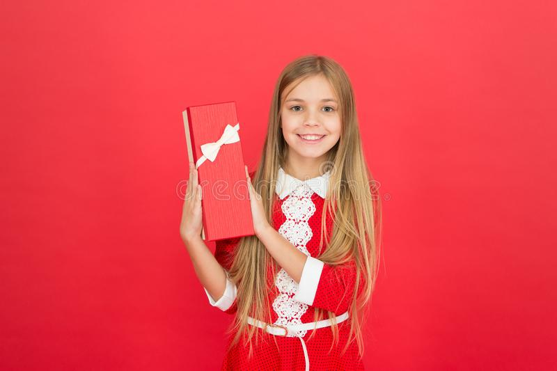 Family and love. childrens day. Childhood happiness. small girl child. School education. Good parenting. Child care. Happy little girl on red background. happy stock photo