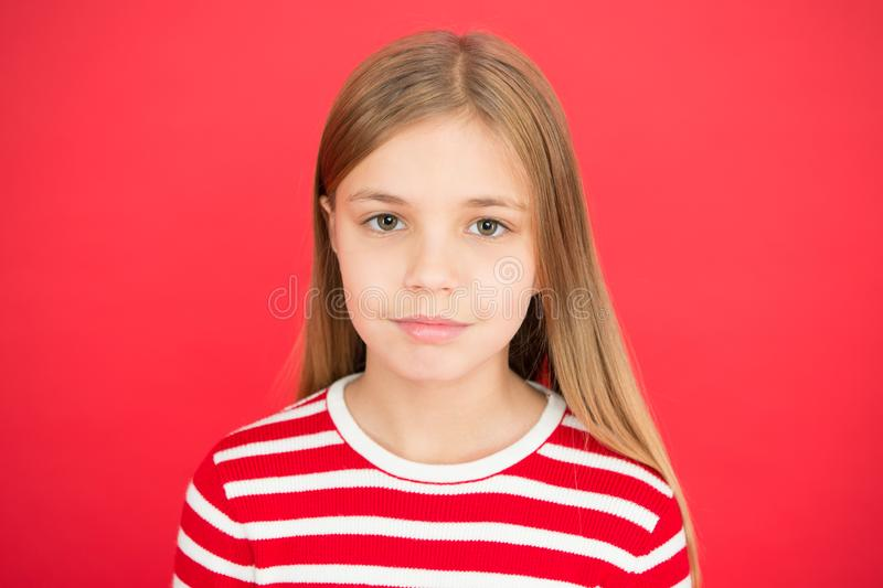 Family and love. childrens day. small girl child. School education. Good parenting. Child care. little girl on red. Background. Childhood happiness. So many royalty free stock photos