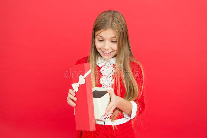 Family and love. childrens day. small girl child. School education. Good parenting. Child care. happy little girl on red. Background. Childhood happiness royalty free stock photography