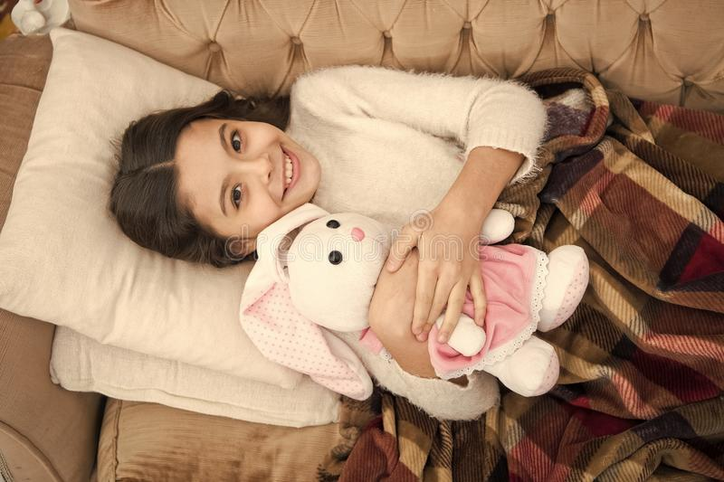 Family and love. childrens day. small girl child. Sweet dreams. Good morning. Child care. happy little girl sleep in bed stock image