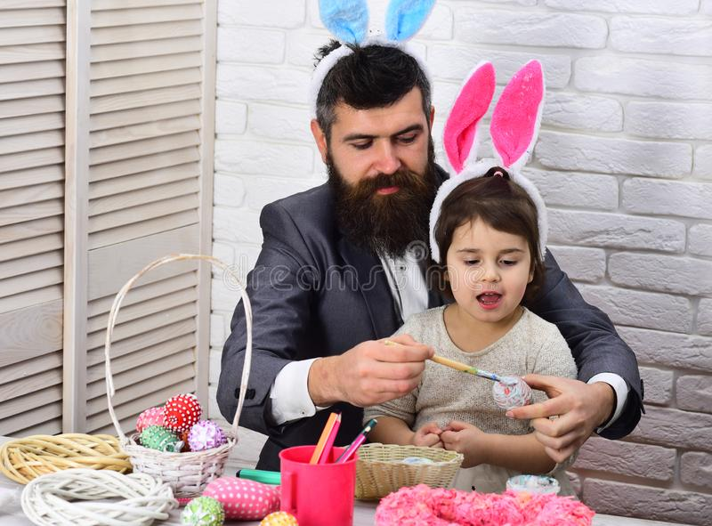 Family love easter. Egg hunt on spring holiday. Happy easter. Childhood. father and daughter paint easter eggs. Rabbit. Family with bunny ears. Delicious Easter royalty free stock images