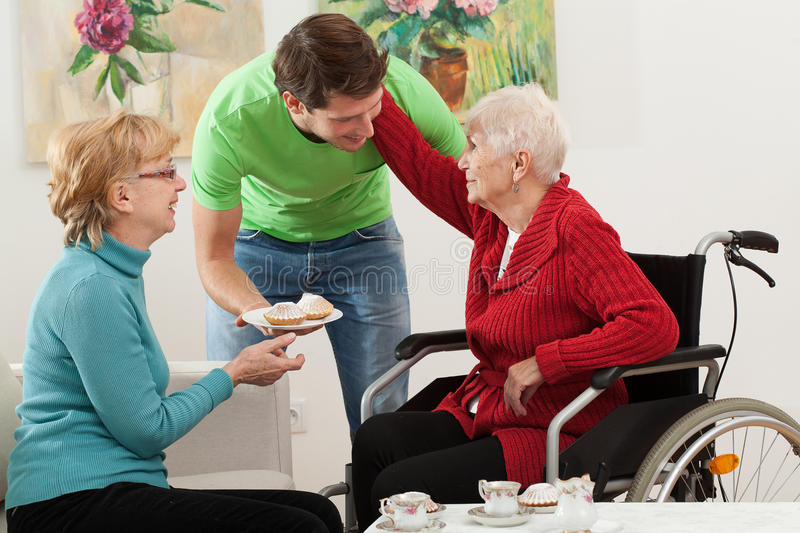 Family love. Family members spending time together with coffee and cake royalty free stock photos