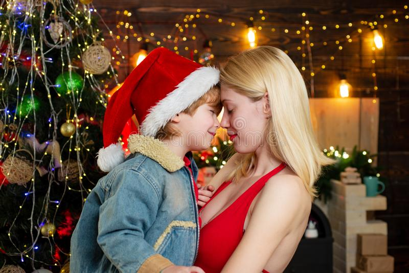 Family love. Mother and baby son celebrate christmas at home. Winter holidays concept. Magic atmosphere family holidays royalty free stock image