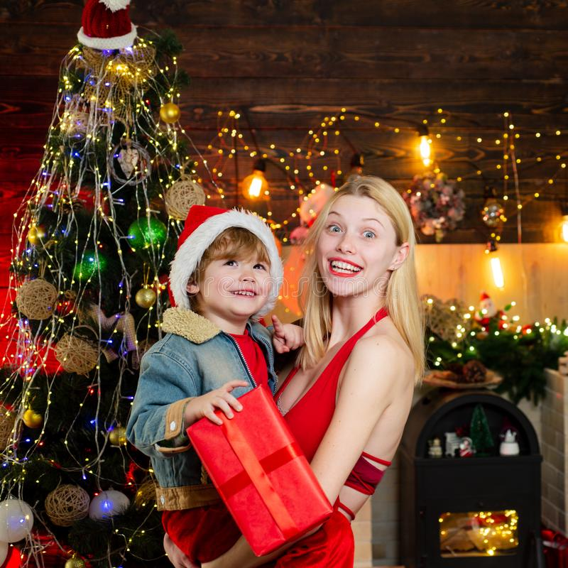 Family love. Mother and baby son celebrate christmas at home. Winter holidays concept. Magic atmosphere family holidays stock photography