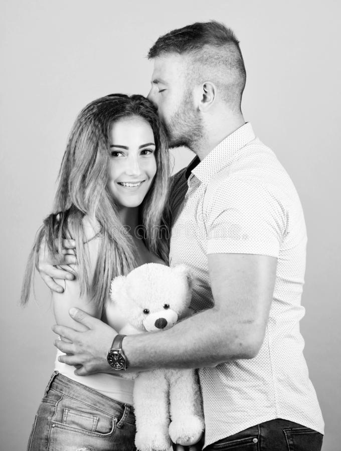 Family love. Romantic surprise. Man and pretty girl in love. Guy and girl cuddling. Enjoying each other. Happy family royalty free stock photos