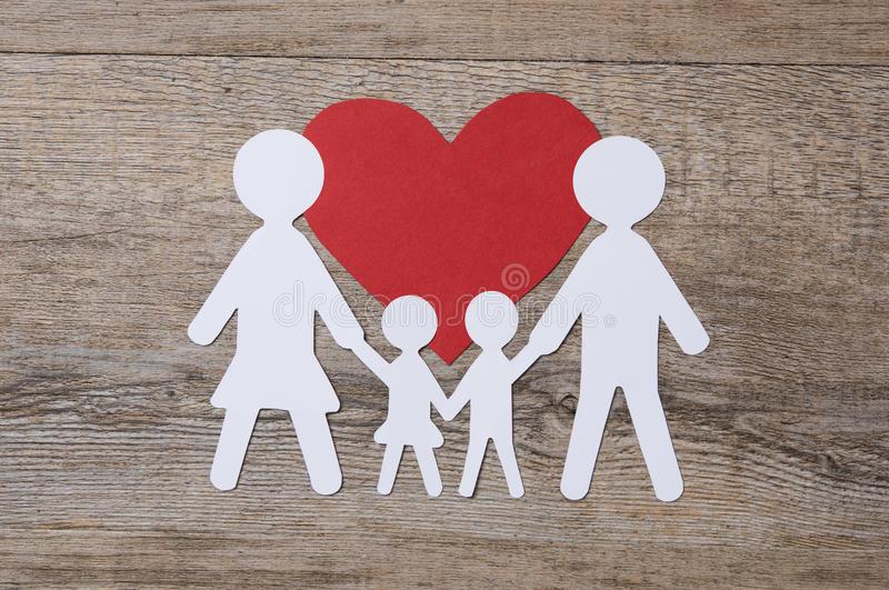 Family in love. Top view of white paper chain family on red shape heart. Family in love. Family care and unity concept royalty free stock photography