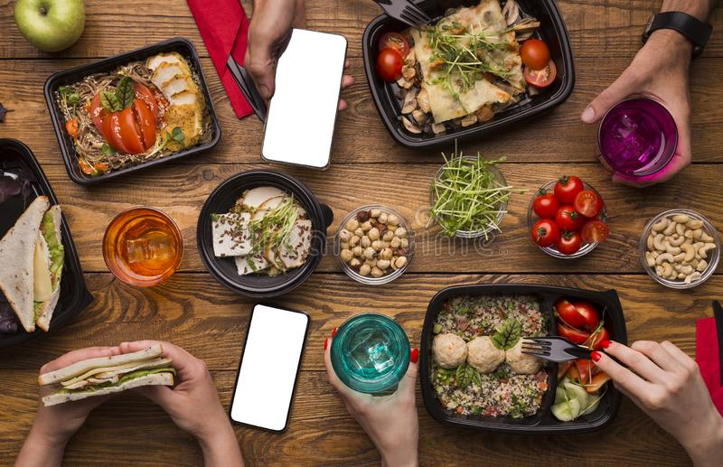 Family lunch at home with healthy meal in take away boxes stock photos