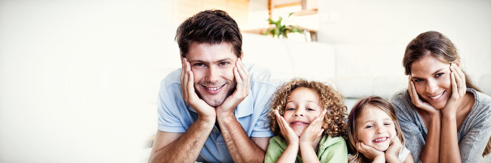 Family lying on a carpet stock images
