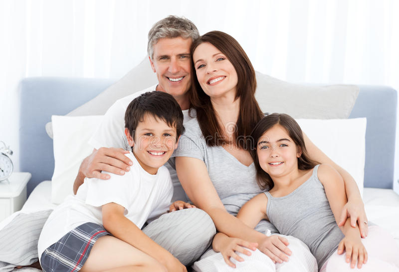 Download Family  Lying Down On Their Bed Royalty Free Stock Image - Image: 17937786