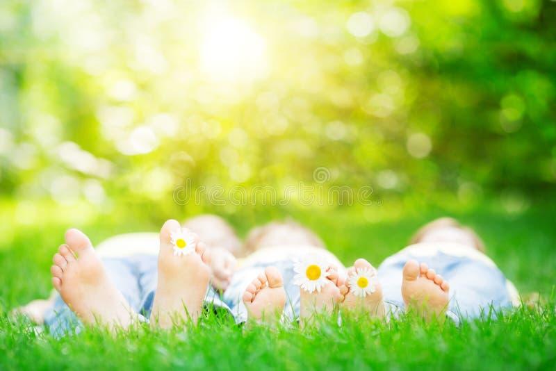 Family lying on grass royalty free stock photos