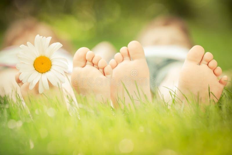 Family lying on grass. Family lying on green grass. Children having fun outdoors in spring park stock photo