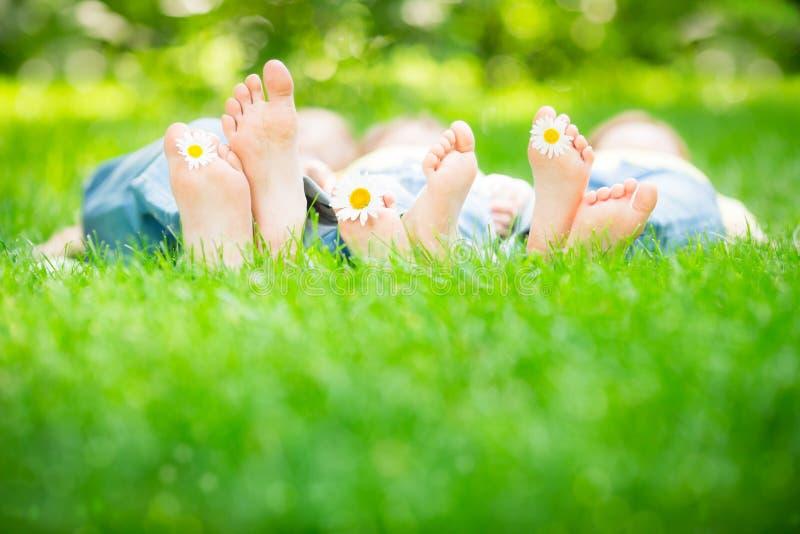 Family lying on grass stock photo
