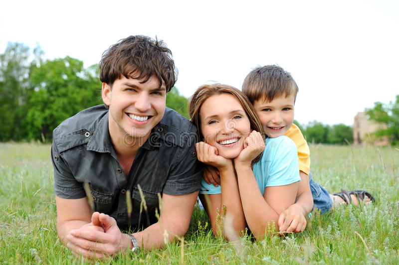 Download Family Lying On The  Green Grass Stock Photo - Image: 15540350