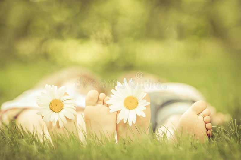 Family lying on green grass. royalty free stock image