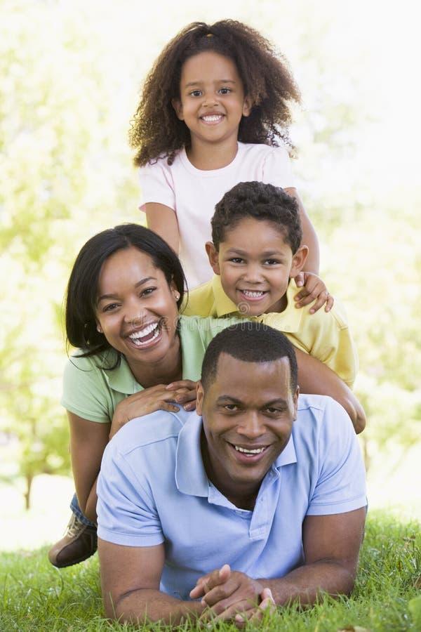 Family lying outdoors smiling. Looking at camera royalty free stock photos