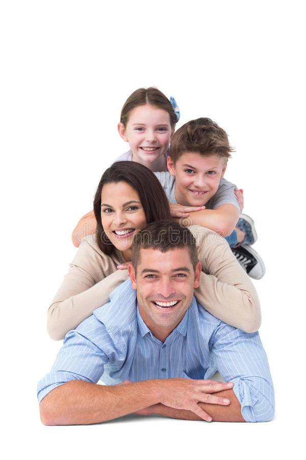 Family lying on top of each other stock photography