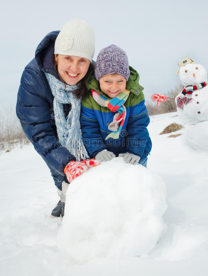 Family make a snowman royalty free stock images