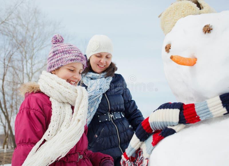 Family make a snowman royalty free stock photos