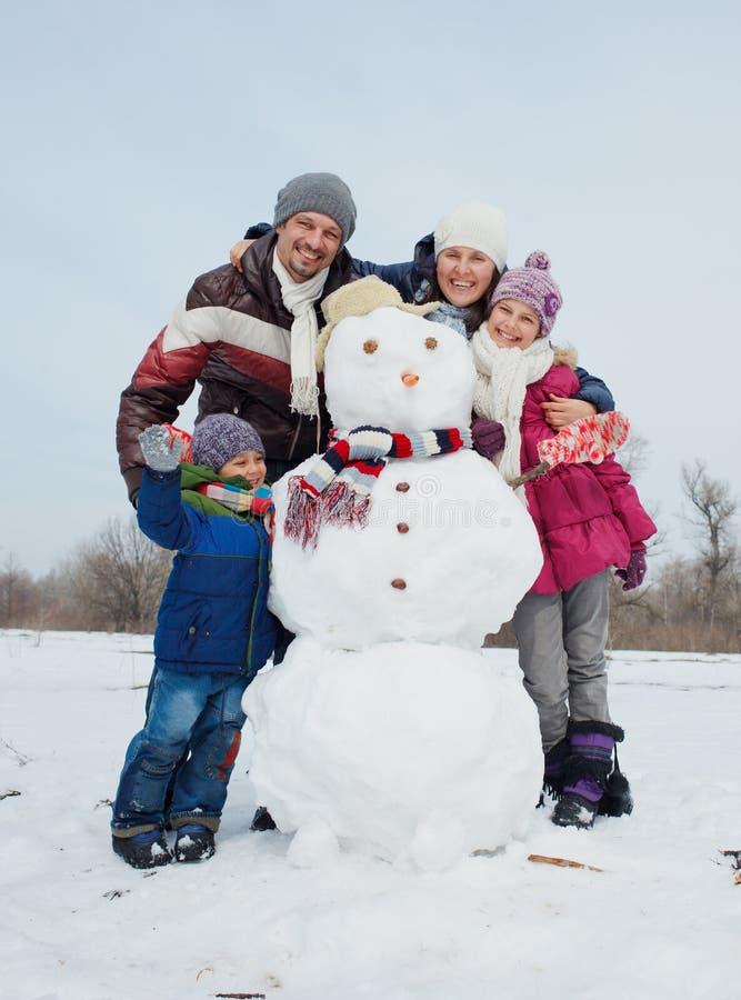 Family make a snowman stock photography