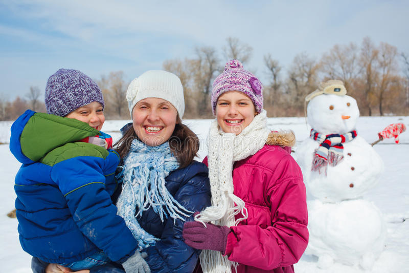 Family make a snowman stock images