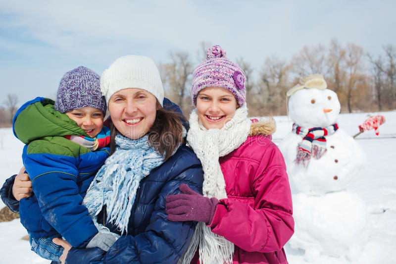 Family make a snowman royalty free stock image