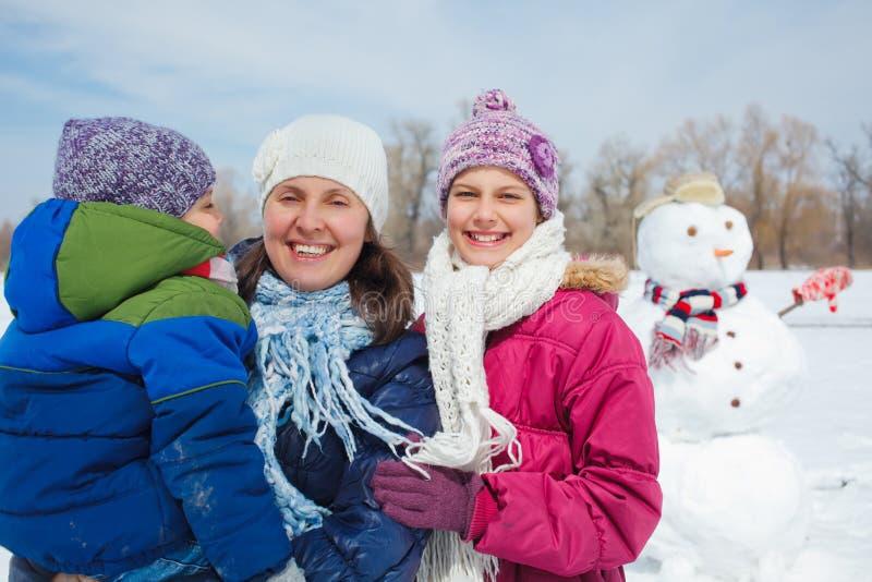 Family make a snowman stock photo