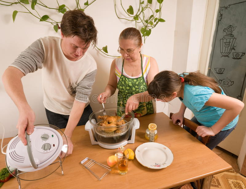 Download The family makes a supper. stock photo. Image of frying - 13058428