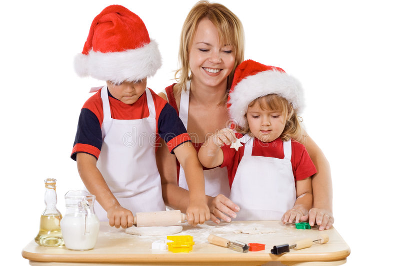 Family making cookies at christmas time stock photography