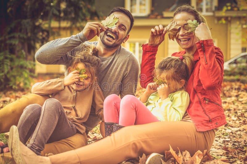 That`s we are. Family making fun , enjoying in autumn season. stock image