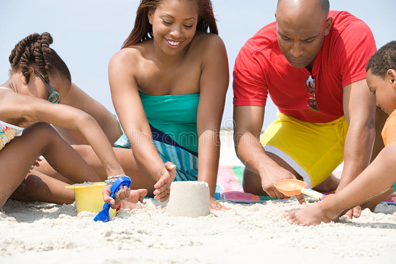 Family making sandcastles stock photography