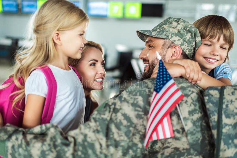Family and man in military uniform royalty free stock photos