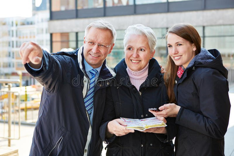 Family with map on sightseeing tour stock photo